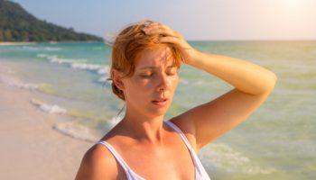 Hitzschlag Sonne Frau Strand